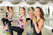 People exercising with dumbbell at gym