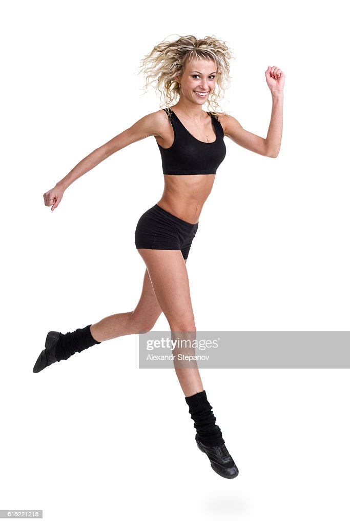 Aerobics fitness woman jumping isolated in full body. : Photo