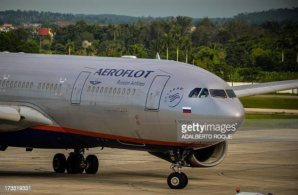 Aeroflot flight 150 aircraft taxies on the tarmac at Jose Marti airport in Havana on July 11 2013 Cuban leader Raul Castro on Sunday said Havana...