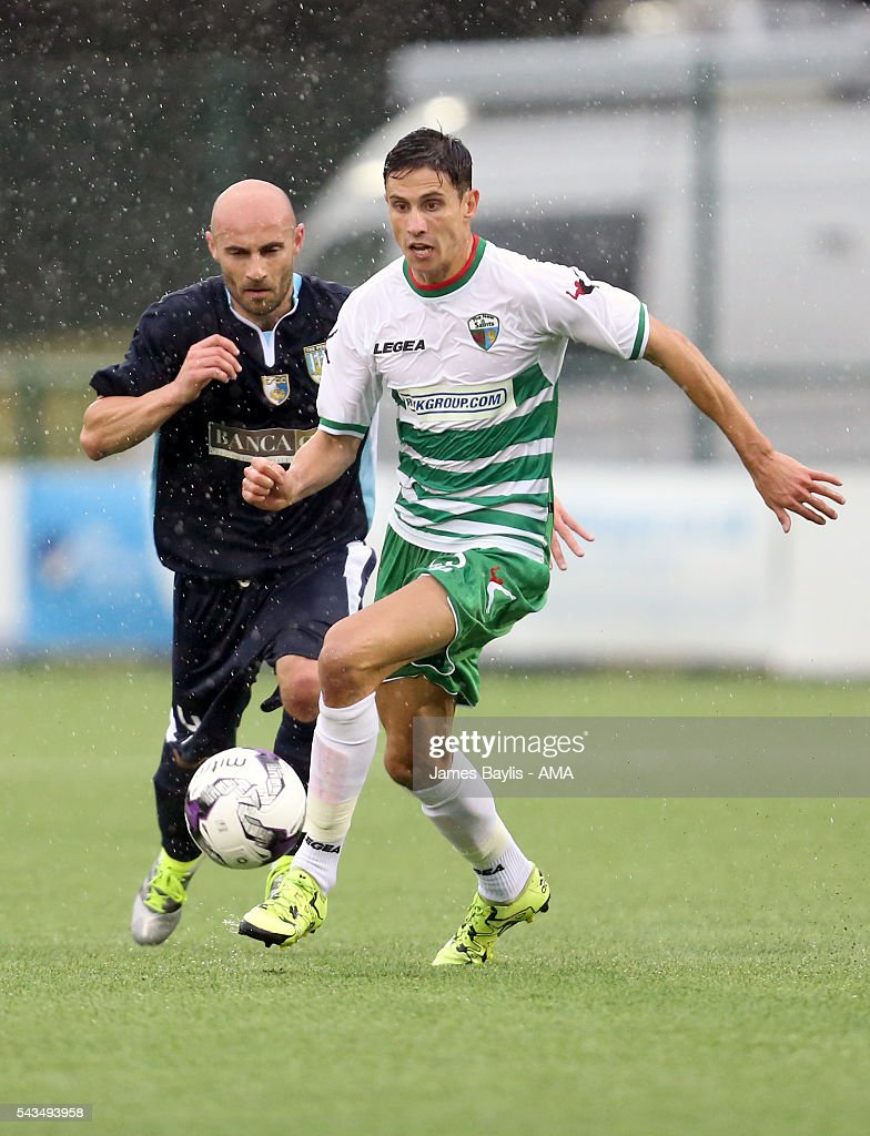 Aeron Edwards of The New Saints and Luca Censoni of SP Tre Penne during the UEFA Champions League First Round Qualifier match between The New Saints and SP Tre Penne at Park Hall on June 28, 2016 in Oswestry, England.
