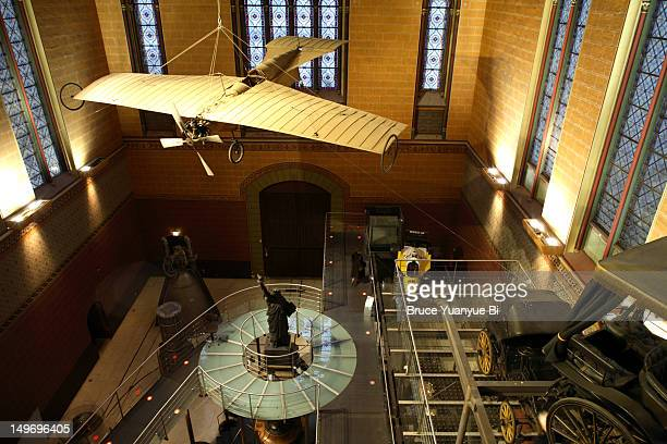 Aeroplane hanging above exhibtion room in Musee des Arts et Metiers.