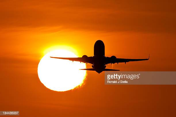 Aeroplane in air at sunrise