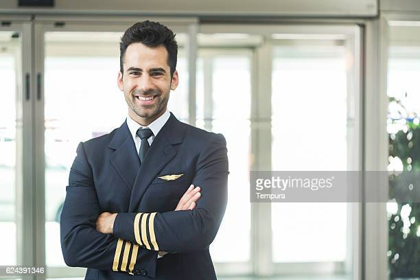 Aeroplane pilot looking at camera and smiling.