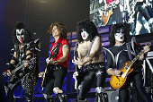 Aerosmith's Joe Perry performs a song with KISS during Aerosmith and KISS in Concert December 18 2003 at The Forum in Los Angeles California United...