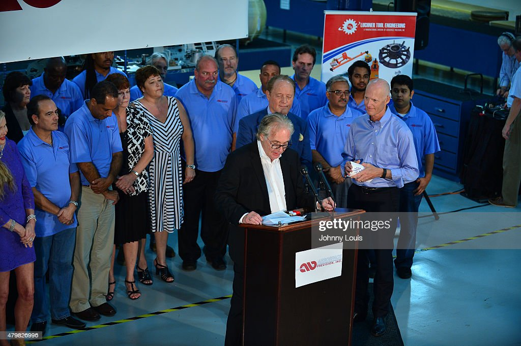 Aerospace CEO Pierre Pinsonnautt and Aerospace Excutive VP Fred Westerfield introducing the Florida Governor <a gi-track='captionPersonalityLinkClicked' href=/galleries/search?phrase=Rick+Scott+-+Politiek&family=editorial&specificpeople=2370892 ng-click='$event.stopPropagation()'>Rick Scott</a> (R) speaks during a news conference at Aerospace Precision after a tour of the facility to highlight job growth in Hollywood on Tuesday July 7, 2015 in Hollywood, Florida.