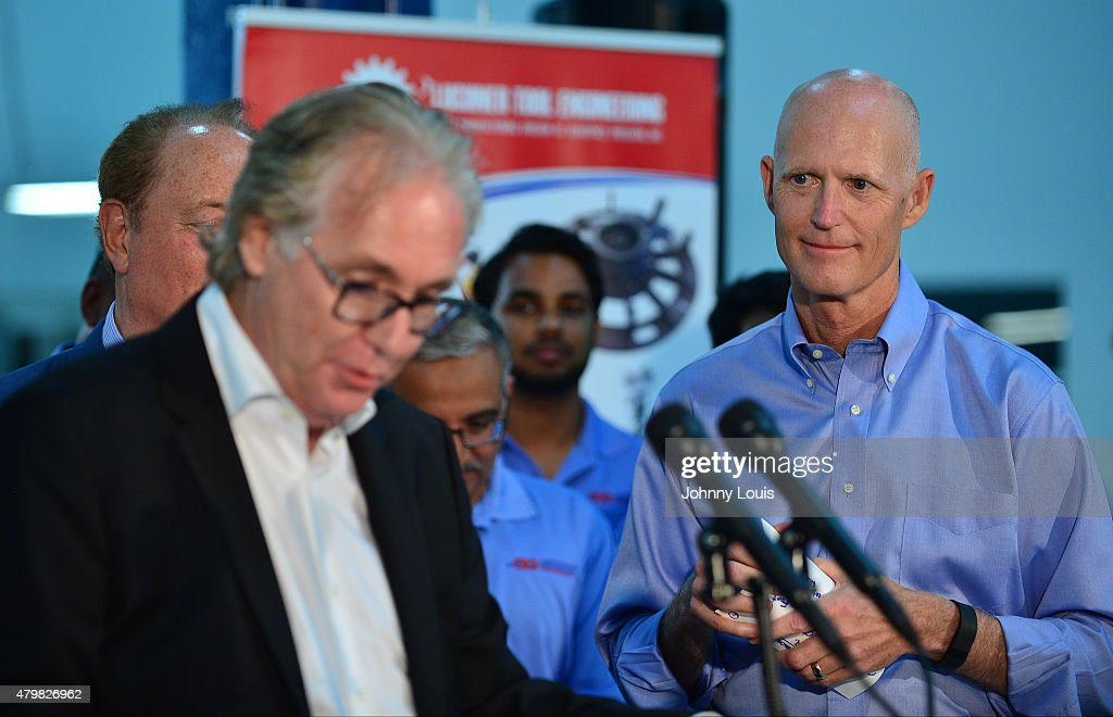 Aerospace CEO Pierre Pinsonnautt introducing the Florida Governor <a gi-track='captionPersonalityLinkClicked' href=/galleries/search?phrase=Rick+Scott+-+Politiek&family=editorial&specificpeople=2370892 ng-click='$event.stopPropagation()'>Rick Scott</a> (R) speaks during a news conference at Aerospace Precision after a tour of the facility to highlight job growth in Hollywood on Tuesday July 7, 2015 in Hollywood, Florida.