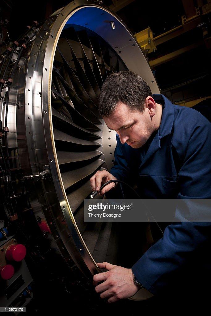 Aerospace technician inspecting reactor : Stock Photo