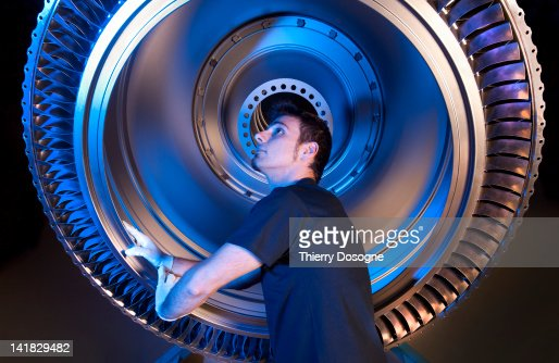 Aerospace technician working in factory : Stock Photo