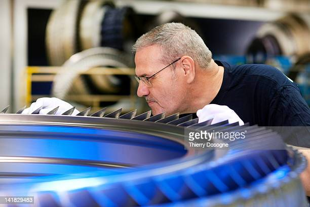Aerospace technician working in factory