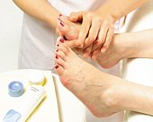 Aesthetician Who Rubs Cream on Womans Leg, Side View
