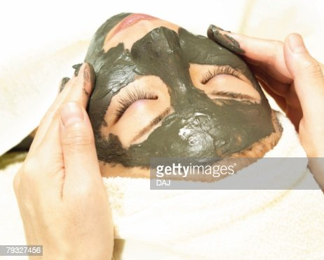 Aesthetician Who Rubs Mud Pack on Womans Face, High Angle View : Stock-Foto