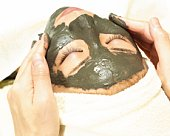 Aesthetician Who Rubs Mud Pack on Womans Face, High Angle View