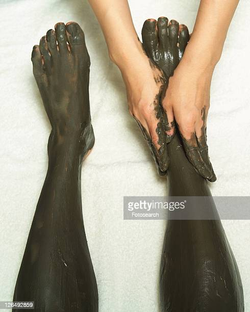 Aesthetician Who Rubs Mud Pack on Woman's Leg, High Angle View