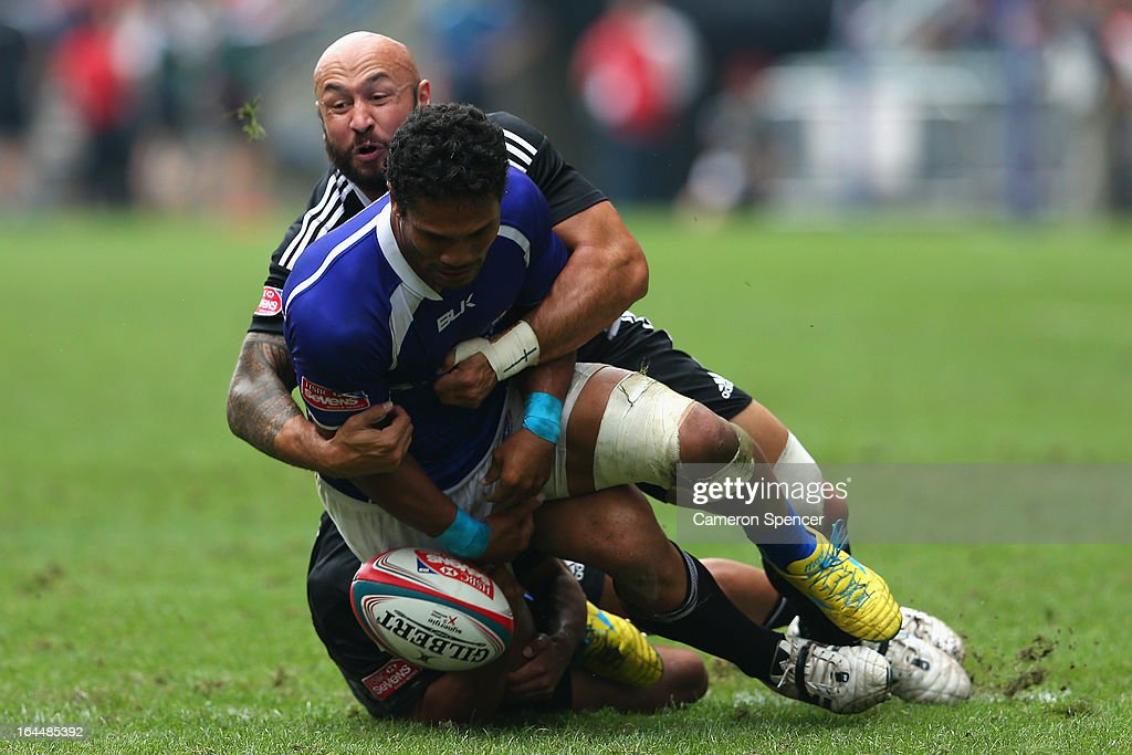 Afa Aiono of Samoa is tackled by D J Forbes of New Zealand during the Cup Quarter Final match between New Zealand and Samoa during day three of the 2013 Hong Kong Sevens at Hong Kong Stadium on March 24, 2013 in So Kon Po, Hong Kong.