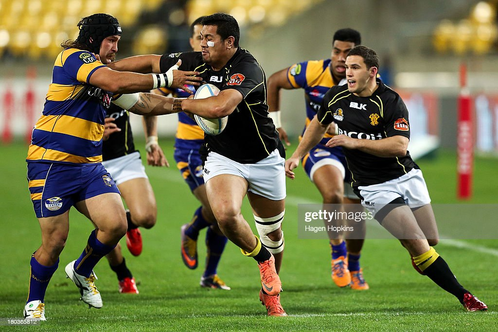 Afa Fa'atau of Wellington fends Joe Royal of Bay of Plenty during the round 5 ITM Cup match between Wellington and the Bay of Plenty at Westpac Stadium on September 12, 2013 in Wellington, New Zealand.