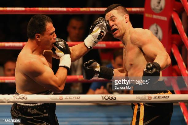 Afa Tatupu punches Joesph Parker during the New Zealand National Boxing Federation heavyweight title at the Trusts Arena on October 10 2013 in...
