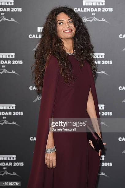 Afef Jnifen and Marco Tronchetti Provera attend the 2015 Pirelli Calendar Red Carpet on November 18 2014 in Milan Italy