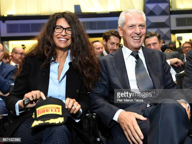 Afef Jnifen and Marco Tronchetti Provero CEO of Pirelli attends a ceremony announcing the return of Pirelli to the Milan StockExchange on October 4...