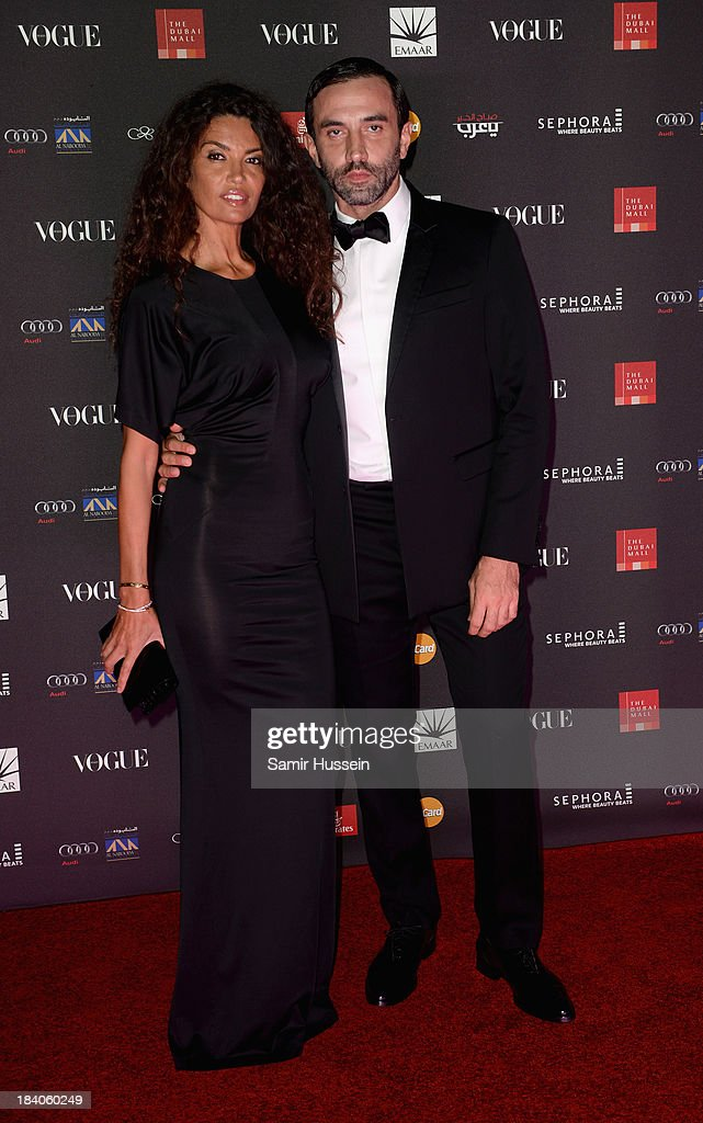 Afef Jnifen and Riccardo Tisci attend the gala dinner at the Armani Pavilion during Vogue Fashion Dubai Experience on October 10, 2013 in Dubai, United Arab Emirates.
