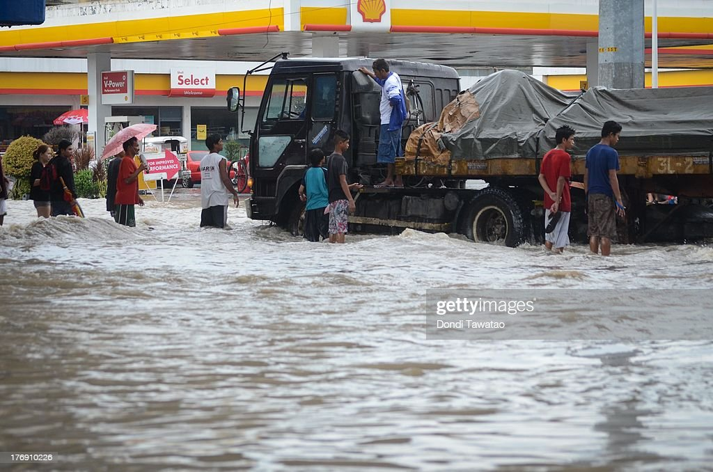 Affected residents hitch a ride on a ten wheeler truck during a downpour that inundated parts of Las Pinas on August 19, 2013 in Las Pinas City south of Manila, Philippines. Tropical storm Trami which was enhanced by monsoon rains swept overnight through the southern metropolitan cities of Manila and leaving huge parts of four provinces flooded forcing residents to evacuate their homes and seek shelter in evacuation centers. At least three fatalities were recorded with thousands more still needing to be rescued.