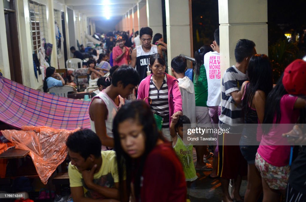 Affected residents take shelter in an elementary school-turned evacuation center in Marikina on August 20, 2013 in Marikina City, west of Manila, Philippines. Schools, government offices and financial markets suspended classes and work except for rescues and disaster response as torrential rains enhanced by the southwestern monsoon inundated much of the metropolis for a second day. Major roads were impassable as floodwaters reached waist or neck deep in some areas forcing thousands of residents living near waterways and creeks to evacuate their homes and seek shelter. At least seven fatalities were recorded with thousands more still needing to be rescued.