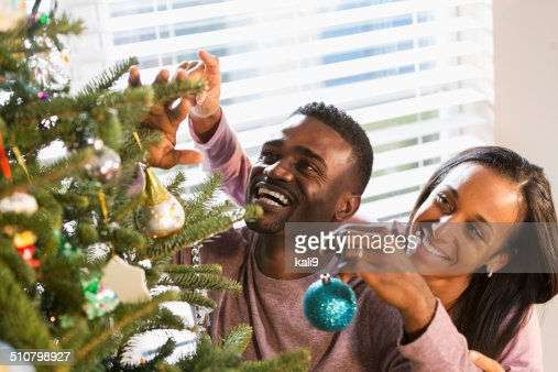 keywords - People Decorating A Christmas Tree