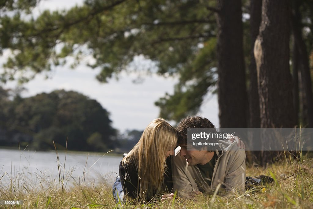 Affectionate couple in field : Stock Photo