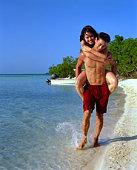 Affectionate couple on seashore