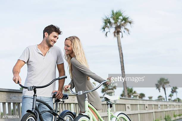Affectionate couple riding bicycles together