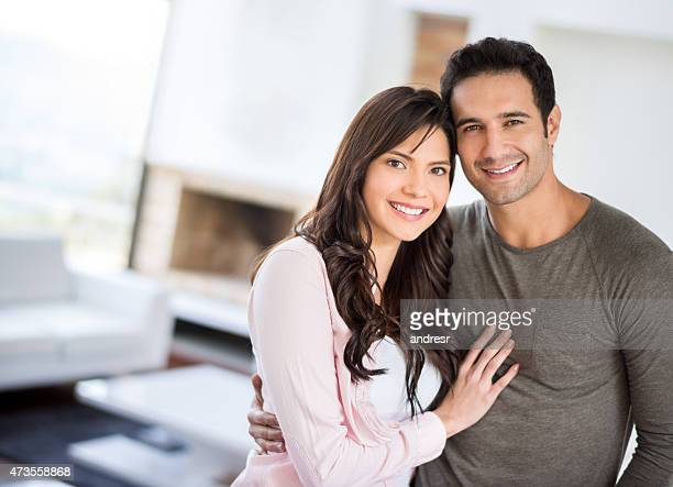 Affectionate Latin couple at home