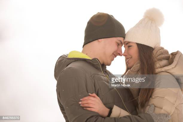 Affectionate love teen couple embracing