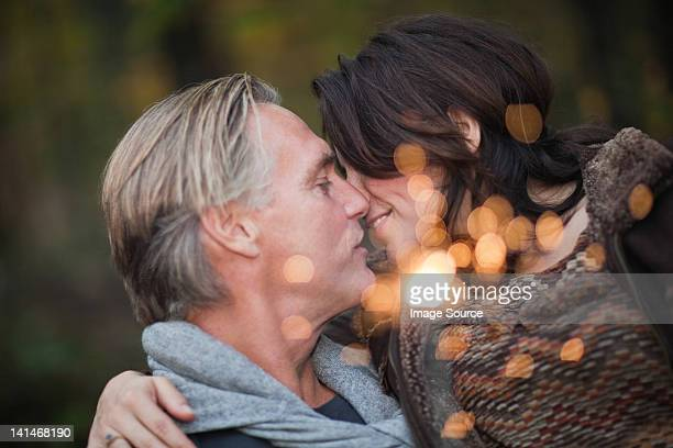 Affectionate mature couple with light from sparkler