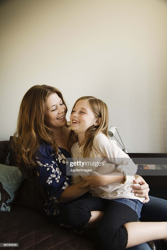 Affectionate mother and daughter : Stock Photo