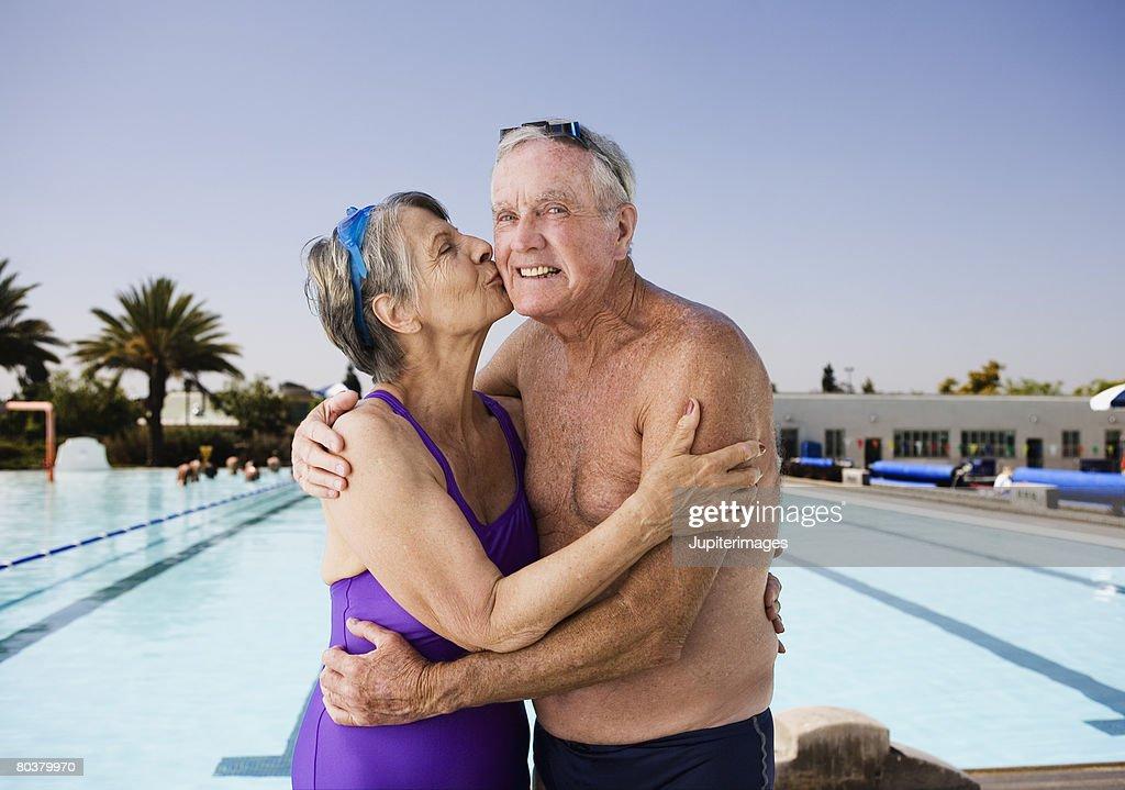Affectionate senior swimmer couple : Stock Photo