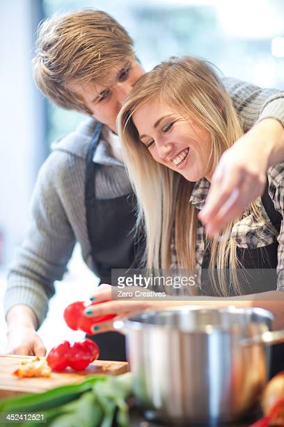 Affectionate young couple preparing meal