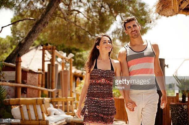 Affectionate young couple walking in a outdoors bar