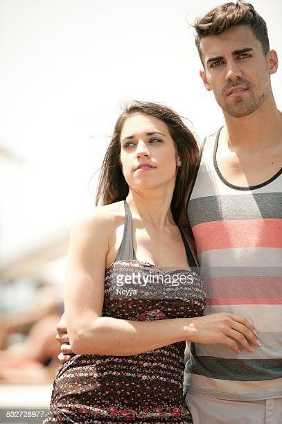 Affectionate young couple walking in a tourist resort