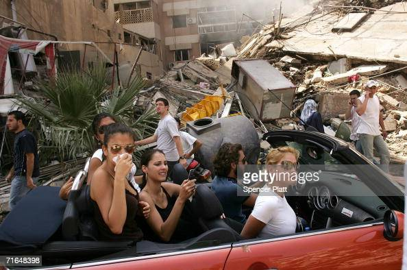 Affluent Lebanese drive down the street to look at a destroyed neighborhood August 15 2006 in southern Beirut Lebanon As the United Nations brokered...