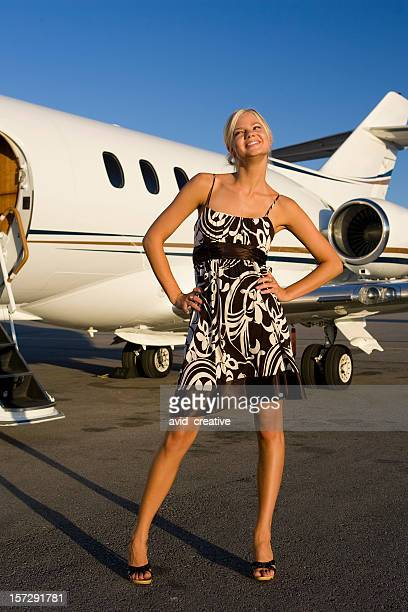 Affluent Travel-Sexy Girl Laughing by Airplane