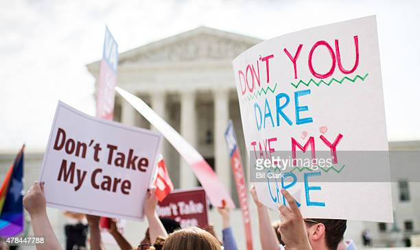Affordable Care Act supporters hold up signs outside the Supreme Court as they wait for the court's decision on Obamacare on Thursday June 25 2015