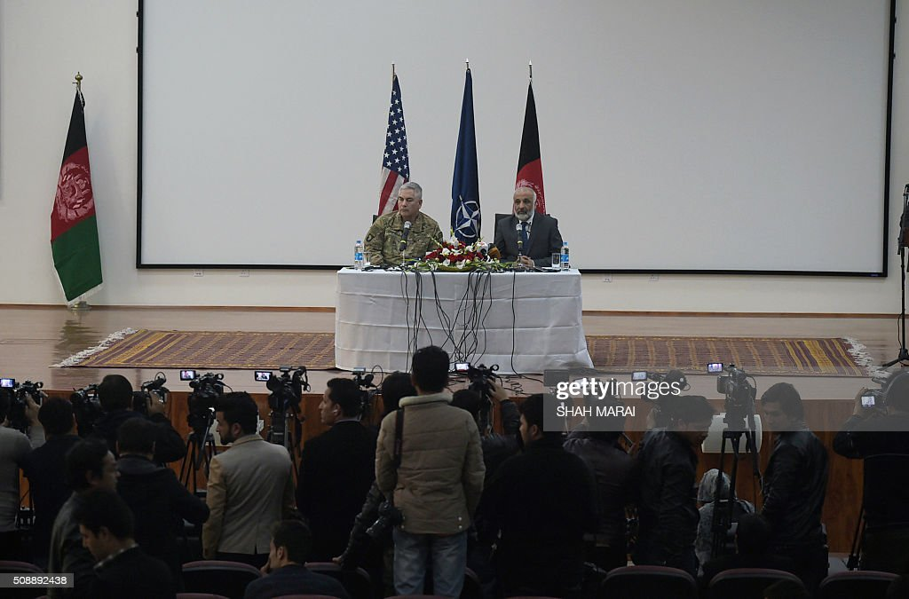 Afghan Acting Defence Minister Masoom Stanekzai (R) speaks during a joint press conference with commander of US and NATO forces in Afghanistan General John F. Campbell in Kabul on February 7, 2016. AFP PHOTO / SHAH Marai / AFP / SHAH MARAI