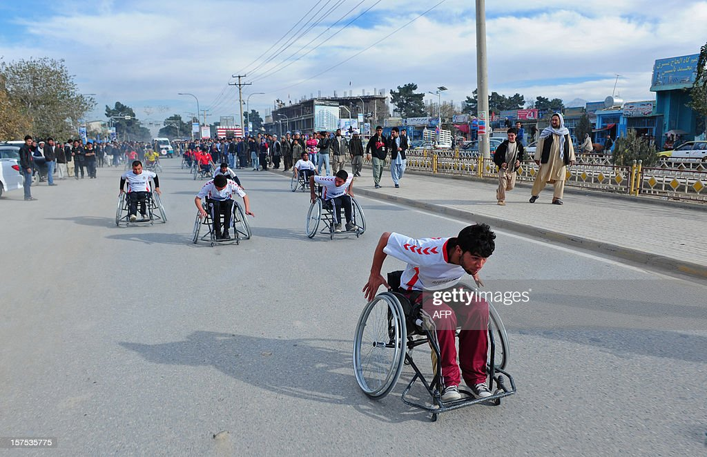 Afghan amputees and war victims participate in a competition organized by the International Committee of the Red Cross (ICRC) in Mazar-i Sharif on December 4, 2012. The ICRC Orthopaedic Project, which began in 1988 in Kabul, now has seven centres in various Afghan provinces.
