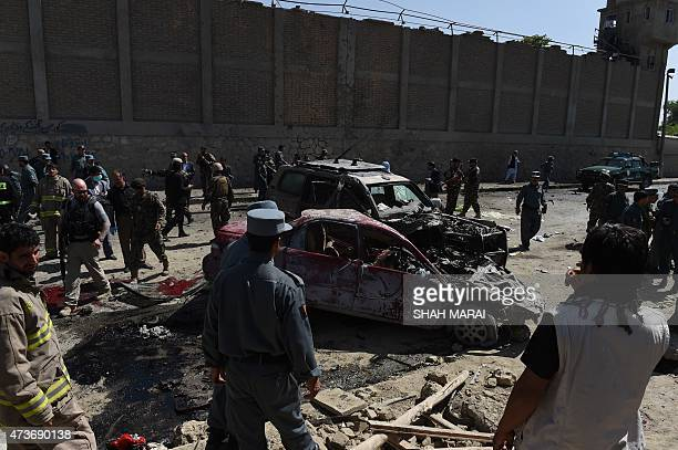 Afghan and foreign security forces inspect the site of a suicide attack in Kabul on May 17 2015 A powerful suicide blast struck near Kabul airport...