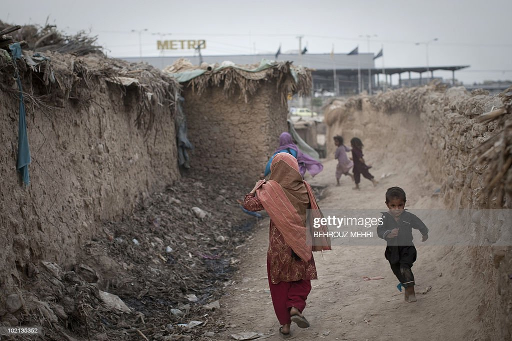 Afghan and Pakistani children run in a slum area in Islamabad on June 15, 2010. Pakistan approached the International Monetary Fund in 2008 and has secured a 11.3 billion USD standby loan in an effort to contain inflation and cope with a rapid depletion of reserves that were barely enough to cover nine weeks of import bills.