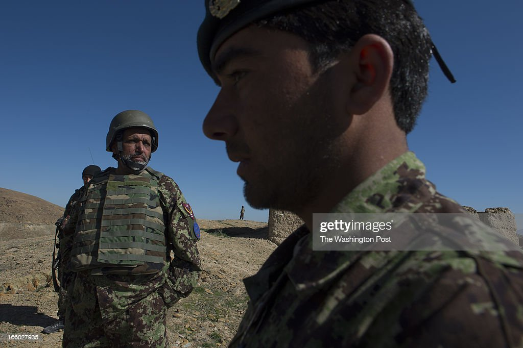 Afghan Army General Abdul Raziq, left, and 1st. Lt. Musif Khan, right, survey an area where recent kidnappings and Taliban activities have occurred in the Village of Mango Khel, Logar Province Afghanistan on Saturday March 30, 2013. Afghan Army soldiers under the direction of General Raqiq, have begun to taken over security and operations from the Americans in Logar and Wardak Provinces.