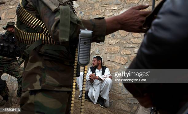 Afghan Army soldiers guard a man known as 'Wazir' a suspected Taliban who was taken prisoner on Tuesday April 2 2013 in Wardak Province Soldiers say...