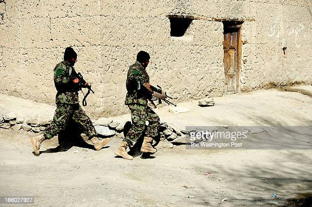 Afghan Army soldiers scurry in a firefight during an operation attempting to remove the Taliban from the area on Tuesday April 2 2013 in Wardak...