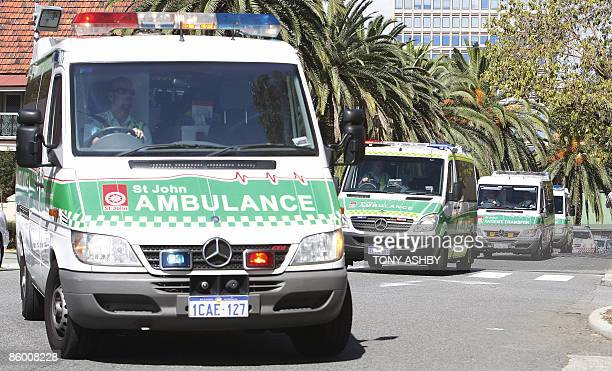 Afghan asylum seekers suffering burns arrive in an ambulance convoy at the emergency section of Royal Perth Hospital in Perth on April 17 2009 47...