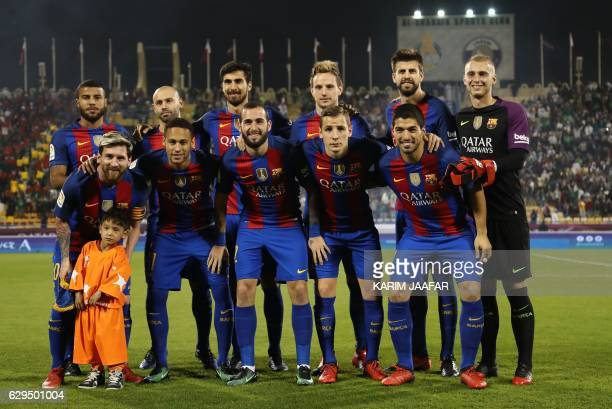 TOPSHOT Afghan boy Murtaza Ahmadi poses for a picture with the FC Barcelona team Rafinha Javier Mascherano André Gomes Ivan Rakitic Gerard Piqué Ter...