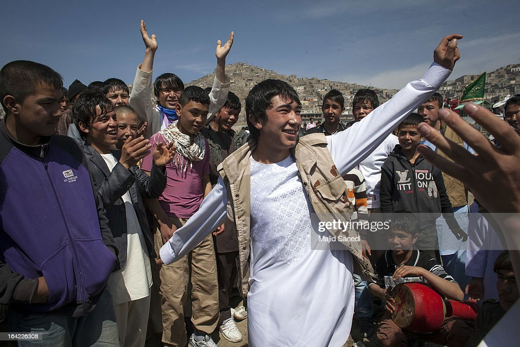 Afghan boys dance during a celebrations near the Sakhi shrine, which is the centre of the Afghanistan new year celebrations during the Nowruz festivities on March 21, 2013 in Kabul, Afghanistan. Nowruz is an ancient festival which marks the beginning of the spring equinox and the start of the year in the Iranian calendar, which this coming year will be 1392.